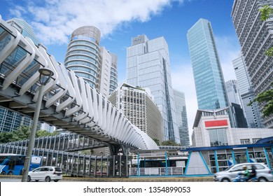 JAKARTA - Indonesia. March 25, 2019: Modern pedestrian bridge with skyscrapers under blue sky in Jakarta city
