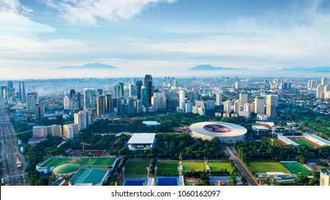 JAKARTA - Indonesia. March 26, 2018: Aerial view of Senayan stadium complex with skyscrapers at misty morning