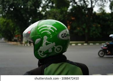Jakarta, Indonesia - March 27 2017: Gojek Driver wearing Helmet with Gojek Logo. Gojek is Indonesian transportation startup
