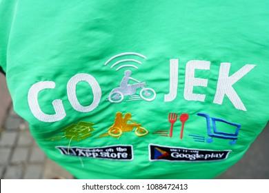 Jakarta, Indonesia - March 27 2017: Driver wearing Jacket with Gojek Logo. Gojek is Indonesian transportation startup