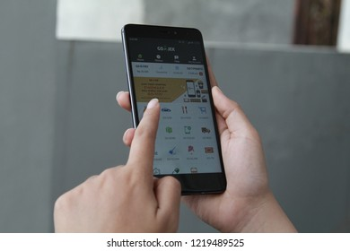 Jakarta, Indonesia - March 27 2017: A woman hand holding Gojek app showing on Xiaomi redmi note 4,Gojek is smartphone app-based transportation network.