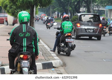 Jakarta, Indonesia - March 27 2017: Grab Bike Riders. Grab is a technology company that offers wide range of ride-hailing and logistics services through its app in Southeast Asia