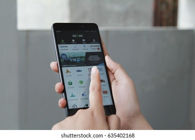 Jakarta, Indonesia - March 27 2017: A woman hand holding Gojek app showing on Xiaomi redmi note 4,Gojek is smartphone app-based transportation network.