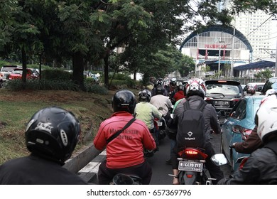 Jakarta, Indonesia - March 27 2017: City traffic in Palmerah Street
