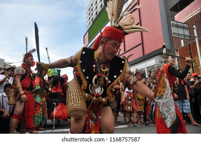 Jakarta, Indonesia - March 4, 2018: Traditional dance from Dayak tribe performance at CapGoMeh Festival, Glodok, Jakarta-Indonesia.