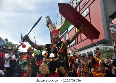 Jakarta, Indonesia - March 4, 2018: Traditional dance from Dayak tribe performance at CapGoMeh Festival in Glodok, Jakarta - Indonesia.