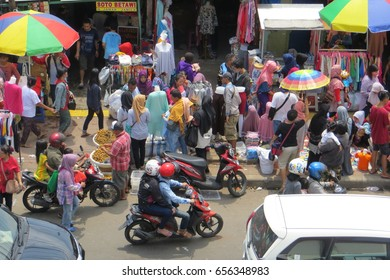 JAKARTA, INDONESIA - March 5, 2017: The street market in Tanah Abang district. The vendor kiosks occupied the pedestrian sidewalk which cause of traffic congestion.