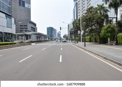 Jakarta, Jakarta / Indonesia - Maret 29 2020 : seen a quiet road on the road MH.Thamrin Jakarta in the result of COVID 19