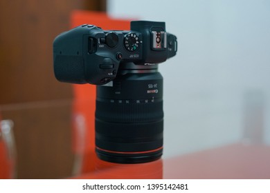 Jakarta, Indonesia - May 12, 2019: The Canon EOS RP full frame mirrorless camera with RF 24-105mm f/4L USM lens. It features a 26MP CMOS sensor and Digic 8 processor.