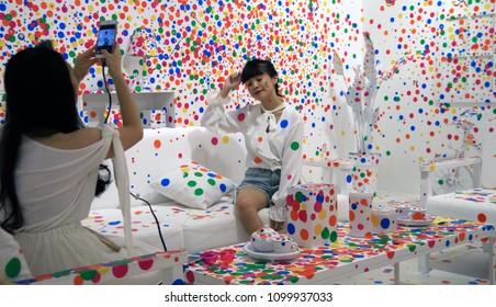 Jakarta, Indonesia - May 16, 2018: Visitor take photos at The Obliteration Room at the YAYOI KUSAMA: Life is the Heart of a Rainbow exhibition held at Museum of Modern & Contemporary Art in Nusantara.