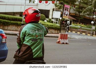 Jakarta, Indonesia - May 2 2018: Gojek driver waiting for passenger. Gojek is Indonesian transportation startup