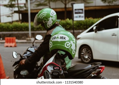 Jakarta, Indonesia - May 2 2018: Helmet with Gojek Logo. Gojek is Indonesian transportation startup