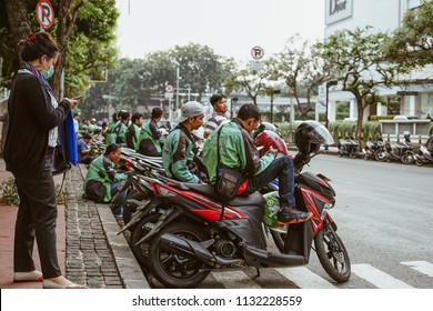Jakarta, Indonesia - May 2 2018: Passenger waiting for Gojek Driver to pick up. Gojek is Indonesian transportation startup