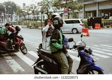Jakarta, Indonesia - May 2 2018: Gojek Driver pick up passenger. Gojek is Indonesian transportation startup