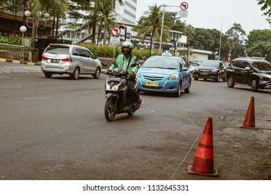 Jakarta, Indonesia - May 2 2018: View of a Sudirman street with a popular motorcycle taxi, Gojek. Gojek is Indonesian transportation startup