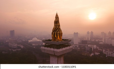 JAKARTA - Indonesia. May 21, 2018: Beautiful aerial sunset view of golden torch of National Monument in Jakarta, Indonesia