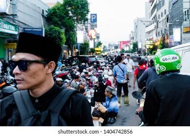 Jakarta, Indonesia - May 22, 2019: The demonstrators break their fast, eat and drink on Sabang street, near the Bawaslu office, Jakarta, Indonesia.