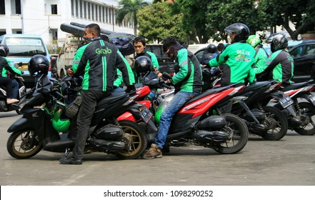 Jakarta, Indonesia - May 24, 2018: Some ojek, motorcycle taxi, waiting passenger in front of Jakarta Kota Railway Station.