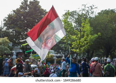 Jakarta, Indonesia - MAY 24, 2020: Protester waving Indonesian flag and Habib Rizieq Shihab picture during President Election Protest in front of  Constitutional Court Jakarta