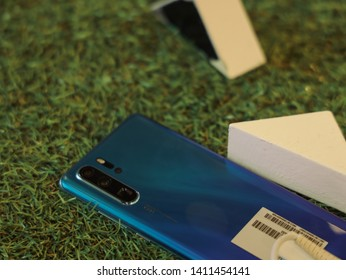 Jakarta, Indonesia - May 30, 2019: The Huawei P30 Pro Android smartphone has 5x optical zoom with Leica quad camera on the back.