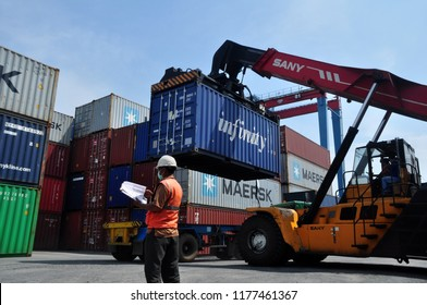 Jakarta, Indonesia - May 6, 2017: Container unloading truck in logistics yard at the port of Tanjung Priok, Jakarta, Indonesia.