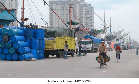 Jakarta, Indonesia - May 6, 2019: Cyclers at Sunda Kelapa Harbour that is considered as oldest harbour, and most of the ship that docked are pinisi, traditional ships model originated from Sulawesi