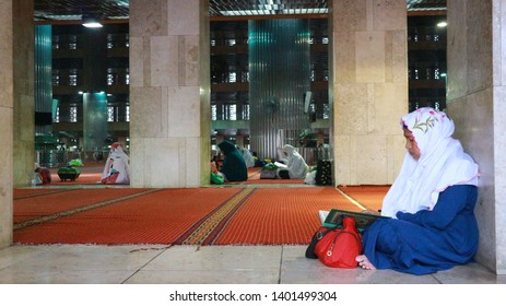 Jakarta, Indonesia - May 9, 2019: Marks of Ramadhan Moslems stays more at mosque recites Al Qur'an and worshipping.  Location is Istiqlal Mosque which considered as biggest mosque in Southeast Asia