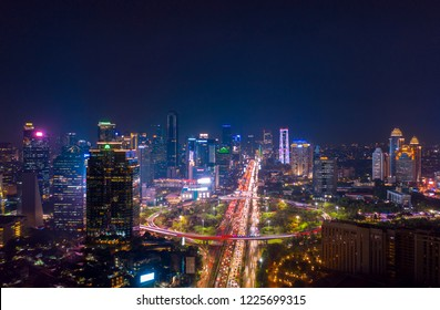 JAKARTA - Indonesia. November 09, 2018: Aerial view of Jakarta city with glowing lights in hectic traffic at night time
