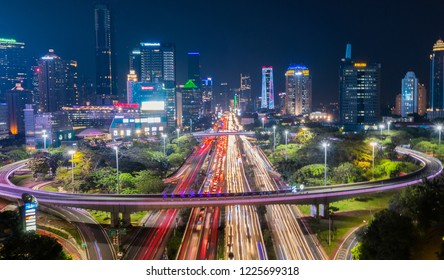 JAKARTA, Indonesia - November 09, 2018: Beautiful scenery of Semanggi road interchange with glowing light on hectic road at night