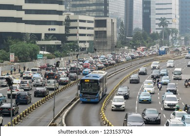 Jakarta, Indonesia - November 09 2018: A transjakarta bus uses its own traffic lane to avoid heavy traffic jam in the heart of Jakarta business district, a very congested area.