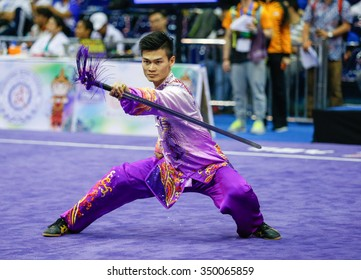 JAKARTA, INDONESIA - NOVEMBER 16, 2015: Jack Chang Loh of Malaysia performs the movements in the Men's Taijijian event at the 13th World Wushu Championship 2015 at the Istora Senayan Stadium.