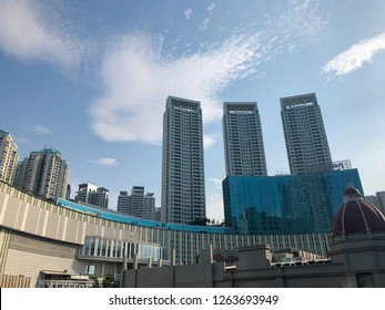 Jakarta, Indonesia - November 19, 2018: Pullman Central Park building exterior view with blue sky.
