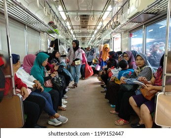 Jakarta, Indonesia - November 20, 2017: View inside the female-only train car of Jakarta Commuter Line at Tanah Abang Station.