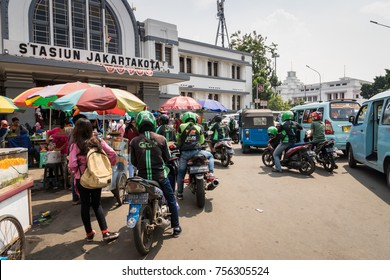 Jakarta, Indonesia - November 2017: Motorbike taxi drivers in Jakarta that work for Grab and Gojek, popular ride-sharing app / service in Asia.