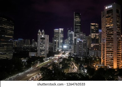 Jakarta, Indonesia: November 2018: The buildings and busy street in the business dristrict of Jakarta city at night.