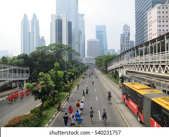 JAKARTA, INDONESIA - November 27, 2016: Sunday morning is a car-free-day in Jakarta. People doing activities on Sudirman road.