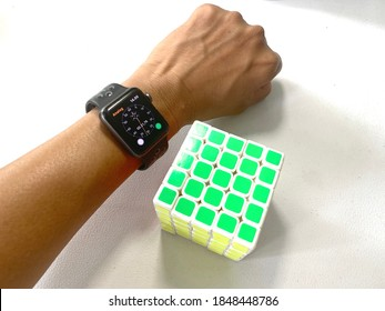 Jakarta, Indonesia - November 5th, 2020 - This is the rubric with hand and apple watch