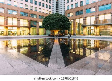 JAKARTA, INDONESIA. OCT 14, 2016: Urban space fountain area with big green tree in the corner with people. This area amid modern office buildings left and right in Central Jakarta, Indonesia.