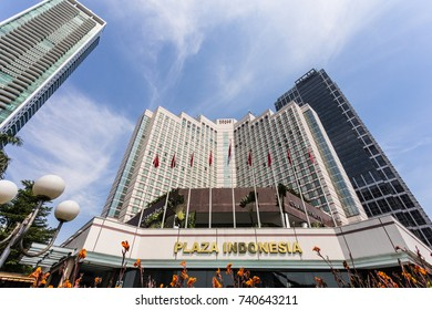 JAKARTA, INDONESIA - OCTOBER 13, 2017: Low view of the luxury hotel, the Grand Hyatt, and other skyscraper that lines the Thamrin avenue in the business district of Jakarta, Indonesia capital city.