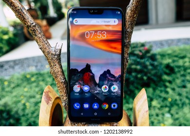 Jakarta, Indonesia - October 14, 2018: The Nokia 6.1 Plus Android One smartphone features a 5.8-inch all-screen front with a notched 19:9 panel.