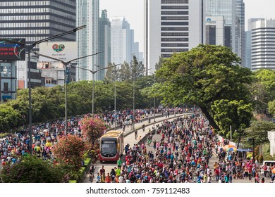 JAKARTA, INDONESIA - OCTOBER 15, 2017: A huge crowd attends the car free day along Sudirman street in the heart of Jakarta business district, where onlyt the tranjakarta buses can run.