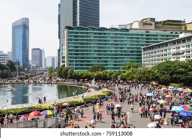 JAKARTA, INDONESIA - OCTOBER 15, 2017: A huge crowd attends the car free day by the Hotel Indonesia roundabout in the heart of Jakarta business district. The event is hold every Sunday morning.