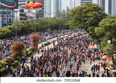 JAKARTA, INDONESIA - OCTOBER 15, 2017: A huge crowd attends the car free day along Sudirman street in the heart of Jakarta business district. The event, hold every Sunday, to fight pollution.