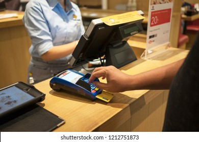JAKARTA - Indonesia. October 15, 2018: Customer paying order by credit card at the restaurant