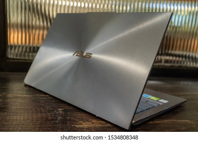Jakarta, Indonesia - October 18, 2019: Side part of ASUS ZenBook S13 UX392 ultra thin laptop.