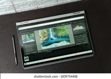 Jakarta, Indonesia - October 24, 2020: The Lenovo IdeaPad Flex 5i 2-in-1 laptop open the Lightroom app in tablet mode.