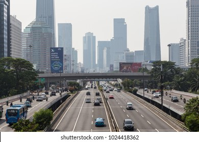 Jakarta, Indonesia - October 27 2017: Traffic rushing along the Gatot Subroto highway by the Semanggi intersection in Jakarta business district in Indonesia capital city.