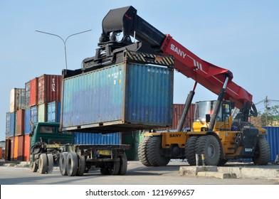 Jakarta, Indonesia - October 28, 2018: Container loading and unloading activities at Sunda Kelapa Harbor, Jakarta - Indonesia.