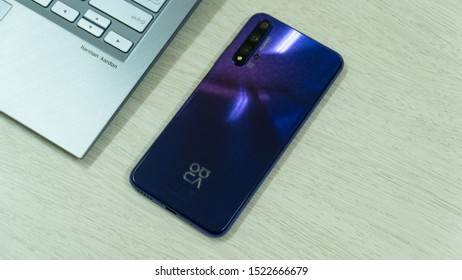 Jakarta, Indonesia - October 5, 2019:  The back of Huawei Nova 5T Android smartphone in Midsummer Purple colour.