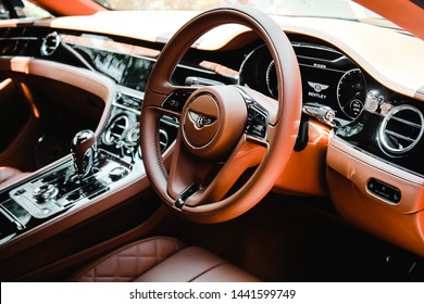Jakarta, Indonesia- October 9th 2018- The new Bentley Continental GT interior with natural grain of wood is contrasted with clean and minimalist crown walnut veneers.